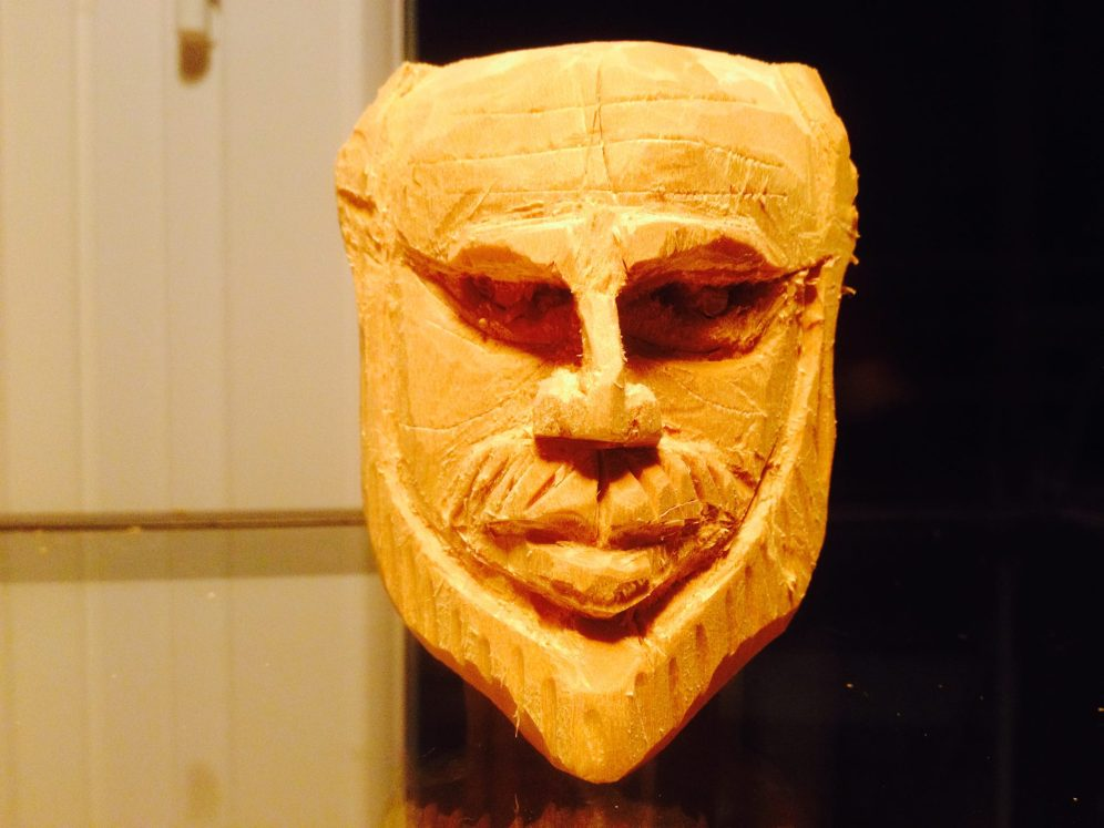 Human face in carved wood